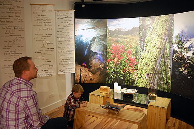 Jason Keerak and his young son catch a few minutes of relative quiet time in the meditation room set up in the Sophie Atkinson Gallery. David F. Rooney photo