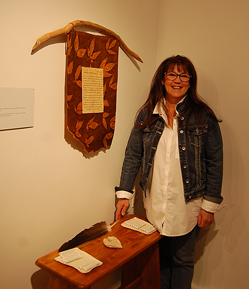 Coreen Tucker poses with her piece, Heart Space. David F. Rooney photo