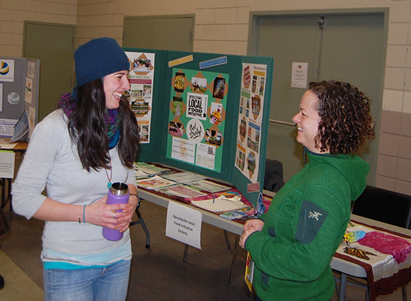 Robyn Hooper of the Columbia Shuswap Invasive Species Society (left) and Melissa Hemphill of the Local Food Initiative share a light-hearted moment at the beginning of the Volunteer Fair. David F. Rooney photo