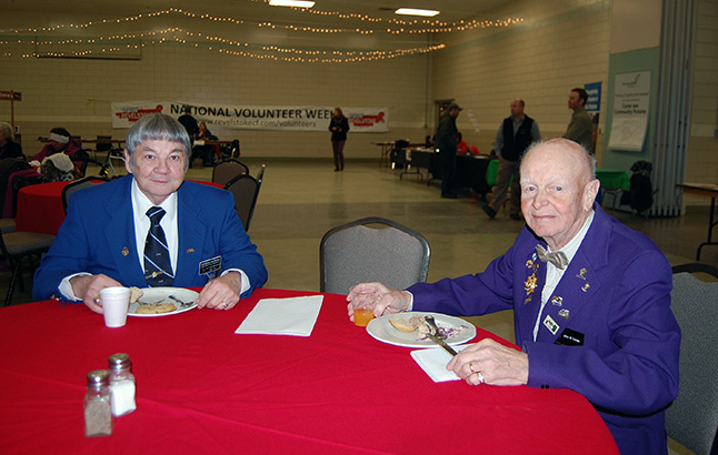 George Hopkins and Jack Carten of Revelstoke Elks Lodge No. 453 crowd down on the pulled pork and macaroni at the fair. These guys understand the power of volunteering. The local Elks lodge has been very active over the years helping kids and works closely with the library, too. David F. Rooney photo
