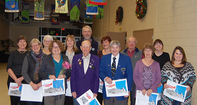 This year's Spirit of Revelstoke award winners were all smiles as they posed for a photo. the awards were presented to Carol Palladino, Claudette Kendel, Wally Mohn, Georgia Sumner, Susan Black, Jan Morehouse, Courtney Atkinson, Cindy Pearce, George Hopkins, Bill Shuttleworth, Jack Carten, Marly McAstocker, Roma Threatful and Vivian Mitchell. David F. Rooney photo