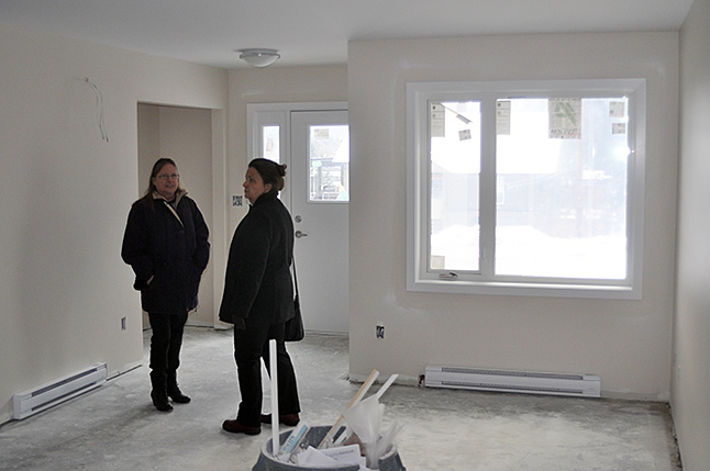 Housing Society Directors Loni Parker (left) and Cathy Girling chat in the living room of one of th projects singe unit. David F. Rooney photo
