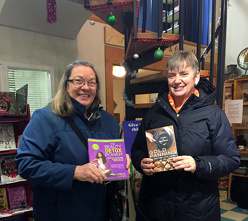 Grizzly Books customers Maralee Faurot (left) and Shelley Hummelink pose for a photo taken when they dropped by to pick up their prizes from the draw.  who won the book, Beauty Detox Power, and Shelley Hummelink, who chose Gold Panning in British Columbia. Photo courtesy of Vanessa Smith