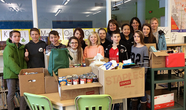 BVE Me To We team with boxed up donations for the food bank. Photo courtesy of Eleanor Wilson
