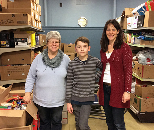 Food Bank manager Patti Larson poses with BVE student Sam Folden and teacher-librarian Eleanor Wilson. Photo courtesy of Eleanor Wilson