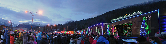 This panorama image gives you a sense of the crowd that turned out for the C Rail Holiday Train on Wednesday, December 16. The afternoon show, featuring performers Jim Cuddy, Devin Cuddy and Kelly Prescott, saw Revelstokians donate 720 pounds of food and contribute $1,186 in cash either directly or by purchasing hot dogs and cocoa from the Fire Rescue Service. To cap it all off, the CPR gave Food Bank Manager Patti Larson a cheque for $10,000. Now that's a heck of a Christmas gift, isn't it? Please click on the image to see a larger version of this photo. David F. Rooney photo