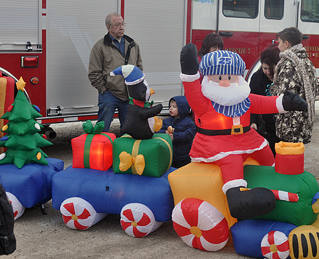 This inflatable Christmas Train invariably attracted the attention of very young children, like this young sir, who appeared to enjoy the penguin. David F. Rooney photo