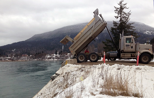 """People out and about in Revelstoke these past few days may have noticed dump trucks loaded with gravel rumbling through town. The trucks poured a total of 5,000 cubic metres of gravel and dirt into the Columbia River at the Centennial Park snow dump site, according to BC Hydro spokesperson Carly Moran. By pouring the gravel into the river, BC Hydro is attempting to renew the gravel bars that would naturally exist along the river. """"Because the Columbia River is dammed, there isn't the gravel washing downstream that there normally would be,"""" Moran said, adding that the gravel and other sediment provide habitat for various forms of aquatic life. The project, which ended today, was led by Angela Korsa, Natural Resource Specialist for BC Hydro. Laura Stovel photo"""