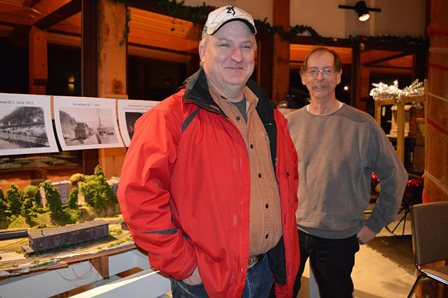 Greg Brule, a member of the Revelstoke Model Railway Club, and museum director Barry Ozero explain the details of the fascinating new Arrowhead diorama which will soon be on exhibit at the Revelstoke Railway Museum. Laura Stovel photo