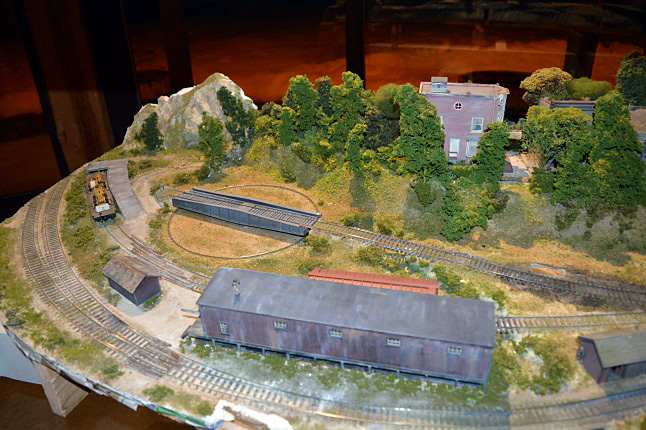"""This addition the Model Railway Club's rapidly evolving diorama depicts the old, manual turntable which turns the train around, said museum director Barry Ozero. """"You had to put the train on and push the train around by hand. There was no machinery to turn it. The train had to be perfectly balanced to get it to revolve properly."""" Laura Stovel photo"""