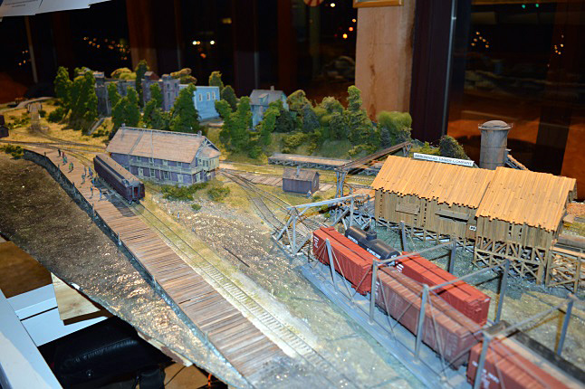 These buildings form part of the Model railway Club's intricate, compressed diorama of Arrowhead, which was unveiled at its Christmas social on Wednesday. The model, complete with railway station, houses, trains and a sawmill, was created and donated by Vancouver resident Brian Pate. Laura Stovel photo