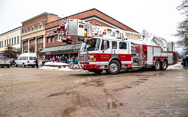 Big shiny Ladder 6 turns the corner from 1st to Mackenzie with sirens blaring and lights shining, like a big Christmas tree on wheels. Jason Portras photo