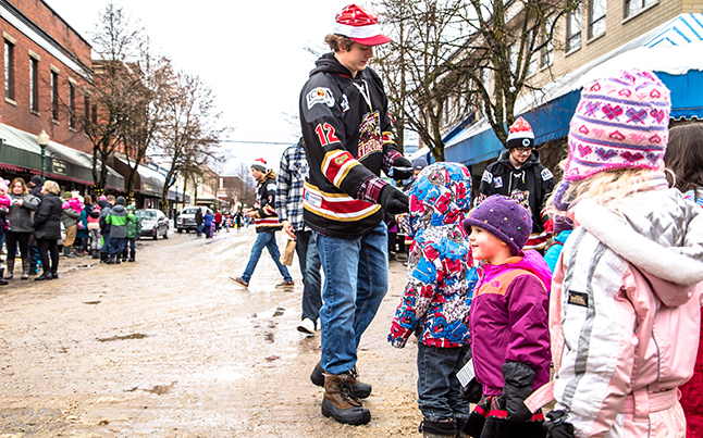 Grizzlies #12 Ethan Waitzner hands out stickers to some very happy children. Jason Portras photo