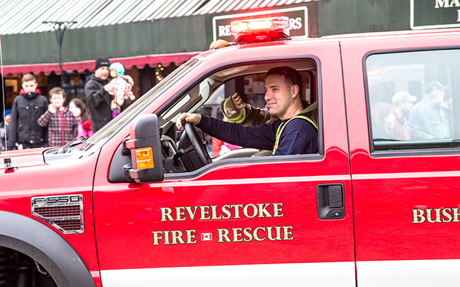 Volunteer Firefighter Glenn McTaggart steers his rig with a smile. Jason Portras photo