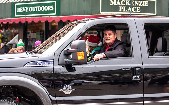 Jacobson Ford's Ken Zmaeff smiles as he chauffeurs Santa in a shiny black F-350. Jason Portras photo
