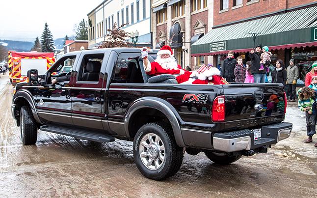 Ol' Saint Nick's new sleigh rounds the corner, driven by horsepower instead of reindeer power. Jason Portras photo