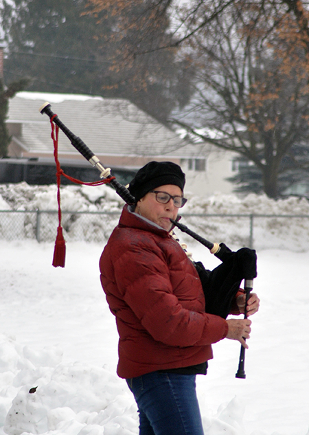 Bagpiper Louisa Fleming plays Amazing Grace to herald the start of the Hospice Society's annual Snowflake ceremony at Queen Elizabeth Park on Sunday afternoon. David F. Rooney photo