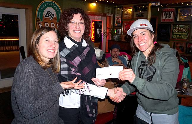 Big-hearted lady sledders raised $2,730 for the Hospice Society during last weekend's first-ever La Niña Charity Ride organized by Snowmobile Society President Nadine Overwater, when on the right handing the cheque to Hospice members Robyn Abear and Heather?? . Photo courtesy of the Revelstoke Snowmobile Society