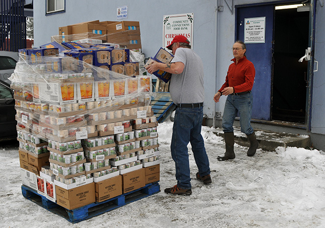 Food Bank volunteers worked to unpack and store three pallets of food delivered by Cooper's on Wednesday. David F. Rooney photo