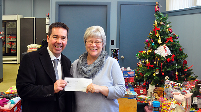 Sterling Land of RBC Wealth Management smiles as he presents Community Connections Food Bank Manager Patti Larson with a cheque for $1,000 from the RBC Foundation on Thursday, December 17. David F. Rooney photo