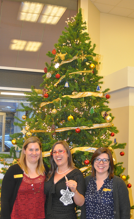 The nice ladies, posing here with the only remaining angel on the Canadian Imperial Bank of Commerce branch's traditional Angel Tree, wish everyone in Revelstoke customers and non-customers alike ± a very Merry Christmas and a Happy and Prosperous New Year. David F. Rooney photo