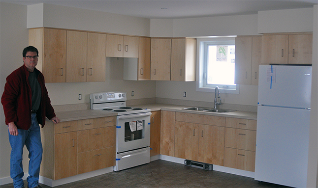 A month ago the Revelstoke Community Housing Society took local news media on a quick tour of the affordable housing units nearing completion on Oscar Street. However, none of kitchens in the two- and one-bedroom units had then be completed. The refrigerators, stoves and cabinets are now being installed and Society Director Glen O'Reilly was kind enough to offer The Current a quick peek at the birch-veneered installations on Monday, January 18. The Society is now accepting applications for these rent-controlled units, which are expected to be open for occupancy in March. David F. Rooney photo