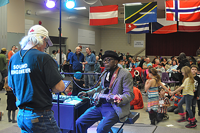 Sound engineer Grant Leiterman finishes his last-minute equipment checks with blues guitarist Wes Mackey. David F. Rooney photo