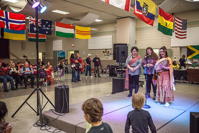 Lisa Moore (left) and Michelle Cole introduce Cori Derikson who danced and told aboriginal folk tales for the crowd. Keri Knapp photo