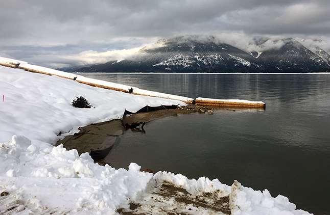 Those logs, all linked by chains, will form one of two wooden breakwaters — one north of the new ramp and walkway and one south of them. Peter Bernacki photo