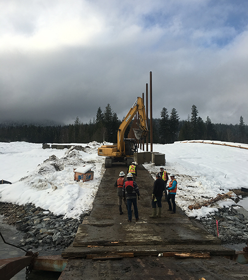 This view from the floating work platform shows workers chatting with Jennifer Walker-Larson and Revelstoke Current Publicher David Rooney. Peter Bernacki photo