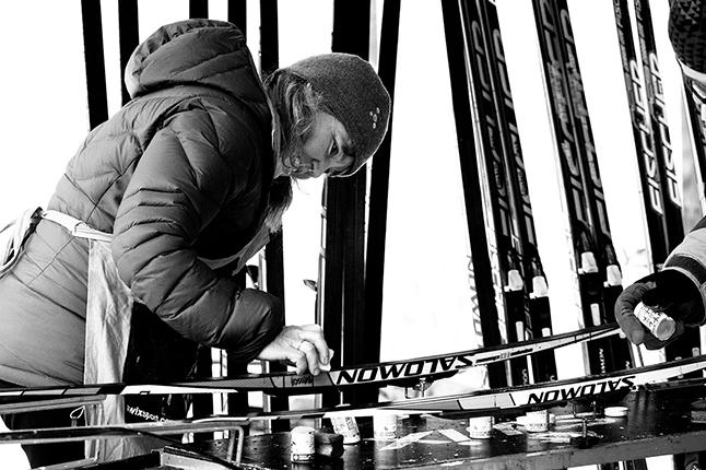 Penny Page-Brittin waxes the Revy team's skis. Rob Buchanan photo