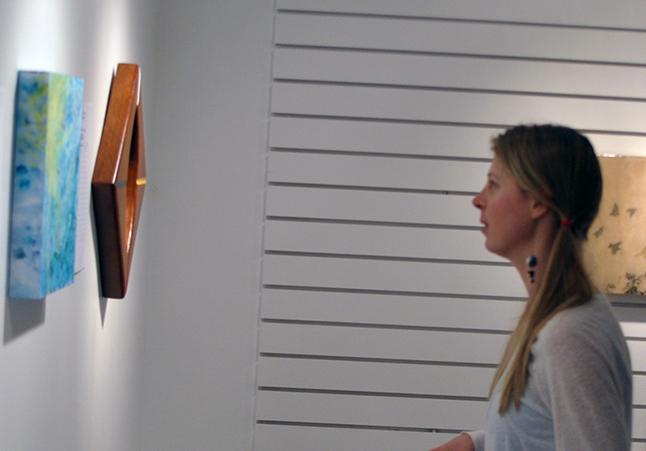 Jocelyn Walker seems mesmerized by one of the paintings on offer. David F. Rooney photo