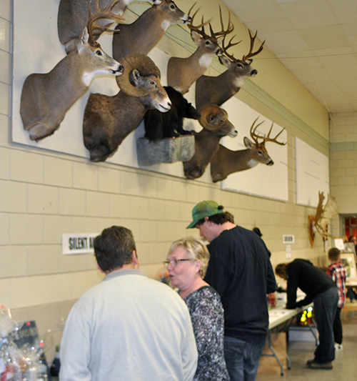 The silent auction saw a lot of bidding on outdoor gear, fishing and hunting equipment. David F. Rooney photo