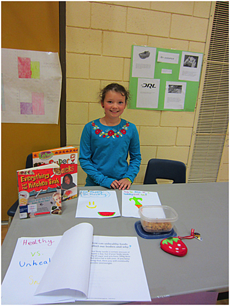 Here is Ruby Pendergast teaching everybody about healthy snacks. Todd Hicks photo. Caption by Emily MacLeod and Amelie Delesalle