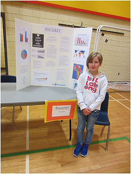 This is Clara Kenyon sharing her project on child poverty. Todd Hicks photo. Caption by Emily MacLeod and Amelie Delesalle