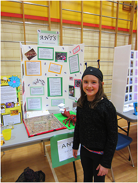 Here is Sabine Tomm displaying her ant project. Todd Hicks photo. Caption by Emily MacLeod and Amelie Delesalle