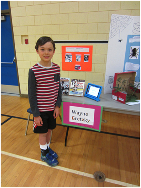 Here is Cameron Norrie showing his Wayne Gretzky project. Todd Hicks photo. Caption by Emily MacLeod and Amelie