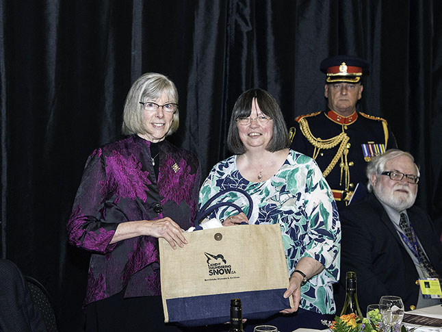 Revelstoke Museum Curator Cathy English presenting the Lieutenant Governor with a gift. Kip Wiley photo