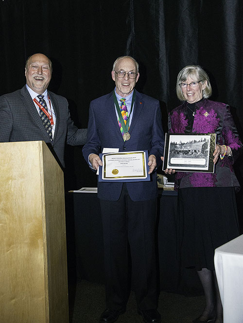 Maurice Guibord, chairman of the conference, Ron Greene, winner of the Lieutenant Governor's Medal For Historical Writing and Lieut.-Gov. Guichon with a copy of his book. Kip Wiley photo