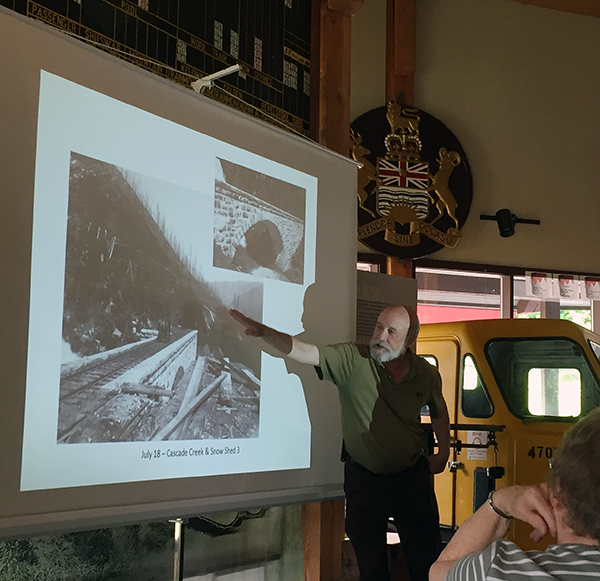 Ralph Beaumont, author of several books on railroads including his latest, Heckman's Canadian Pacific: A Photographic Journey, gestures during a special presentation at the Railway Museum on Thursday, May 26. About 55 people attended the presentation. Beaumont's beautiful book chronicles the photographic career of Joseph Heckman who was tapped b the CPR to photograph everyone of its bridges, stations and snowshed on the main line. Here's an interesting factoid: To do this Heckman travelled 7,000 miles in a hand cart between 1898 and 1915. This high-quality tome is 328 pages in length and is fascinating to look. It's worth every penny of its $63 price and is available at the Railway Museum's gift shop. David F. Rooney photo