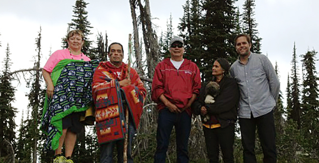 """From left to right: Tigger, Barry Moses, Virgil Seymour, Shelly Boyd and Nick Irving at the top of Mount Revelstoke. Shelly prayed in the nsyilxen language and Barry led the singing during this deeply emotional visit. """"Canada was not safe for us,"""" Virgil often said, even though most Sinixt territory was in this country. The Canadian government would not recognize Sinixt land rights and, only belatedly, created a very small reservation for the """"Arrow Lakes Indian Band"""" at Oatscott on the Lower Arrow Lake in 1902. In a sense this worked as an administrative sleight of hand, deliberate or not, which ultimately led to the disappearance of a whole tribe on the Canadian books. (Even today, bizarrely, Parks Canada employees are forbidden from publicly mentioning the Sinixt. The plaque at the Monashee Lookout on Mount Revelstoke which discusses aboriginal land use does not mention them, even though they were the main group on this land at the time of contact. Incredibly, Parks Canada employees cannot even mention that the Sinixt were here historically, even though it would seem that something that was extinct – if they were – could still be named. Parks Canada does talk about dinosaurs). Laura Stovel photo"""