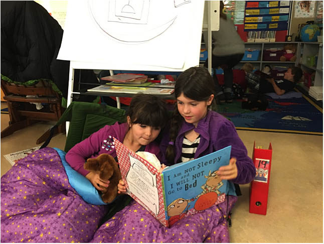 Here are Presley Jean and Madelyn Skerry reading together. Photo By Natalie MacLeod. Caption by Emily MacLeod, Amelie Delesalle and Rebecca Grabinsky.