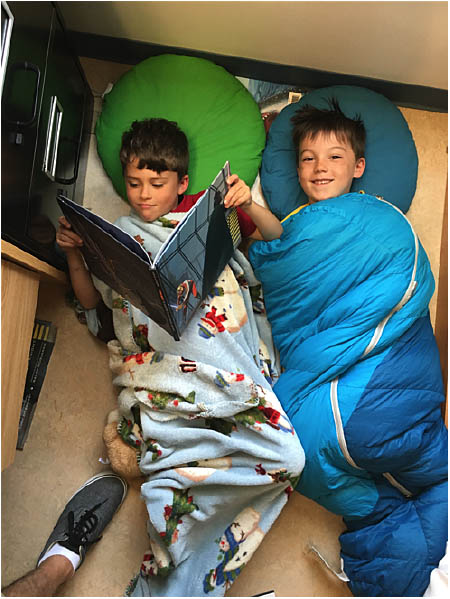 Aidan Schott and Levi Maloney looked pretty comfy reading together. Photo by Todd Hicks. Caption by Emily MacLeod, Amelie Delesalle and Rebecca Grabinsky.