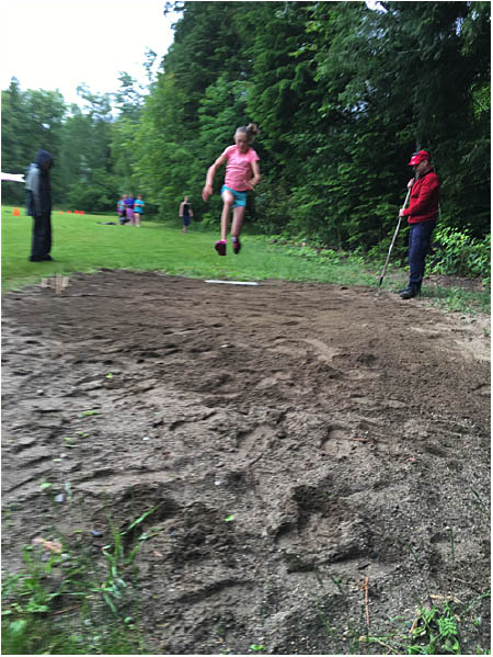 Here is Emily MacLeod taking a leap at the long jump pits. Photo by Todd Hicks. Caption by Emily MacLeod, Amelie Delesalle and Rebecca Grabinsky