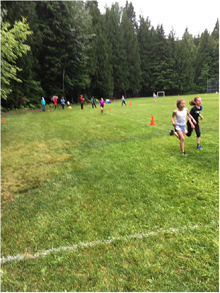 This is Ruby Serroya and Meya Musseau taking the lead in the running race. Photo by Todd Hicks. Caption by Emily MacLeod, Amelie Delesalle and Rebecca Grabinsky