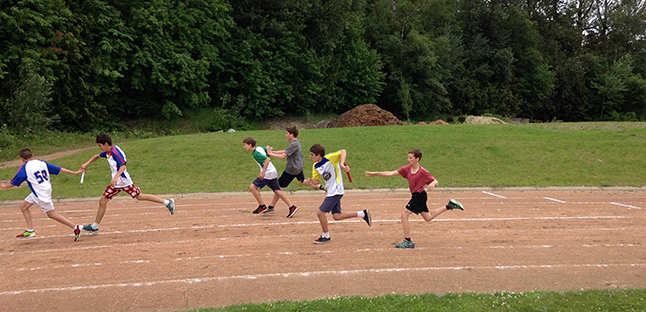 This photo shows the Grade seven 4 x 100 metre hand off from Carlos Serrouya to anchor Adam Carter. Photo courtesy of School District 9