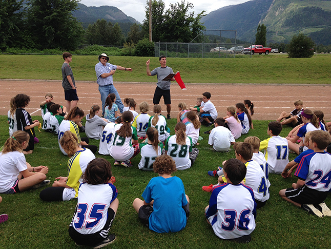 Mr. Hicks, our new principal for next year, gives BVE athletes a pep talk before the 200-metre race. Photo courtesy of School District 9