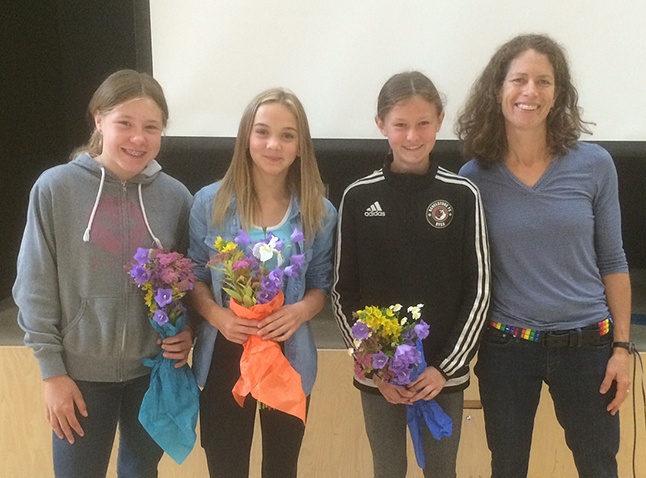 Amy Harder, Kaity Herle, Fia Cameron, and teac her Sarah Newton rpose after a ceremony in the BVE gym where this year's record breakers were recognized. Photo courtesy of School District 9