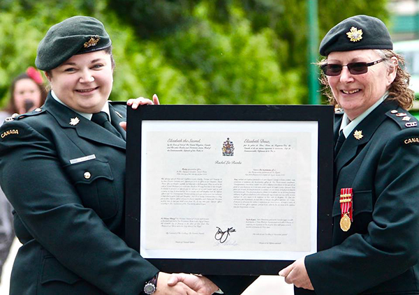 The Canadian Armed Forces Commissioning Scroll was awarded to Second Lieut. Rachel Rienks by Lieut.-Col. Peter. Photo courtesy of Capt. Miken Rienks