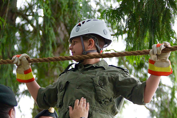 After the formal review, local cadets showed off some of their skills. Here, Cpl. Anakin Walker demonstrates how to use a rope bridge. Photo courtesy of Capt. Miken Rienks